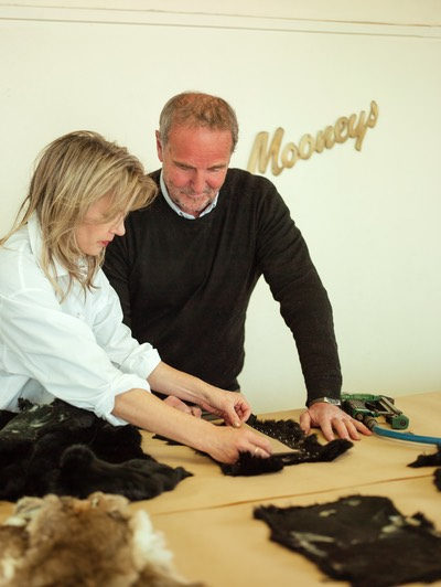 Furrier Max Wilson of Mooneys Furs and Designer Jane Avery measuring patterns