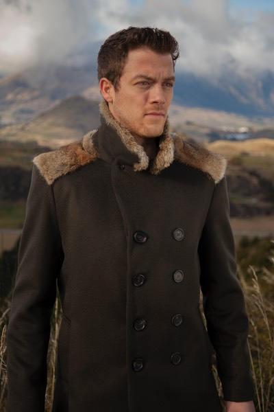 Lapin Homme Mens khaki woolen pea coat with natural New Zealand wild rabbit fur on location in Queenstown