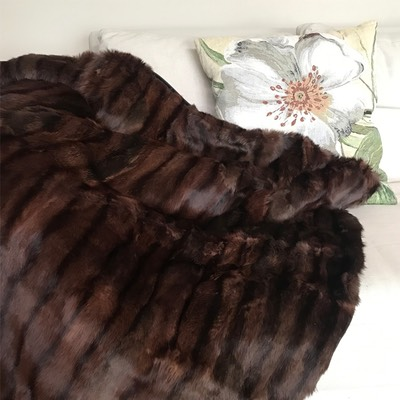 Lapin ReVintage repurposed rabbit fur coat to couch throw